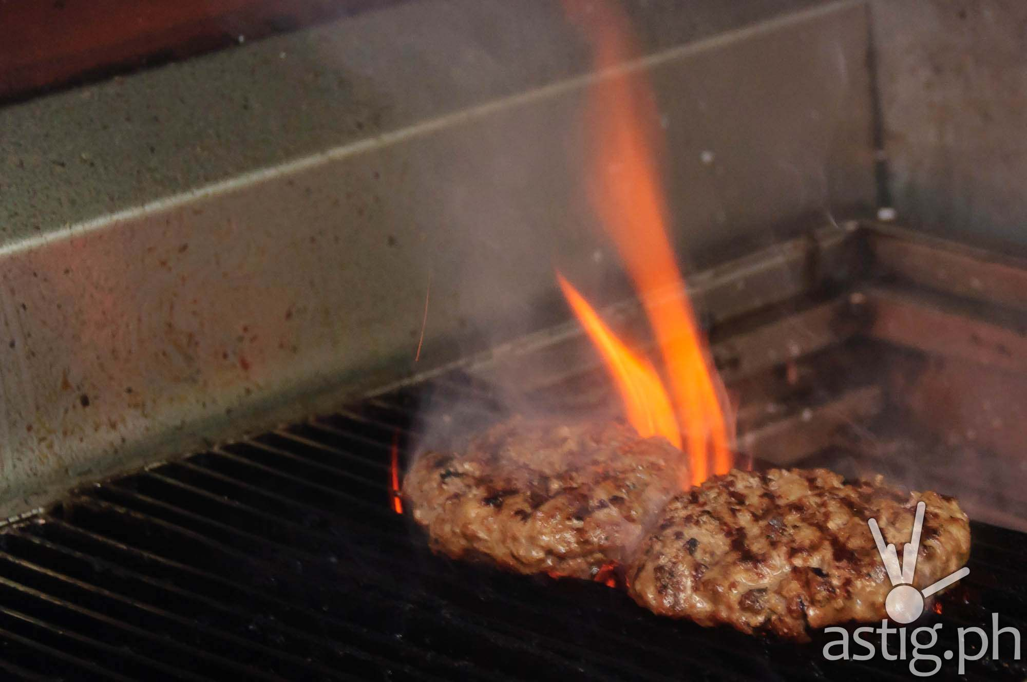 Burger patties being cooked at Wham! Burgers MOA