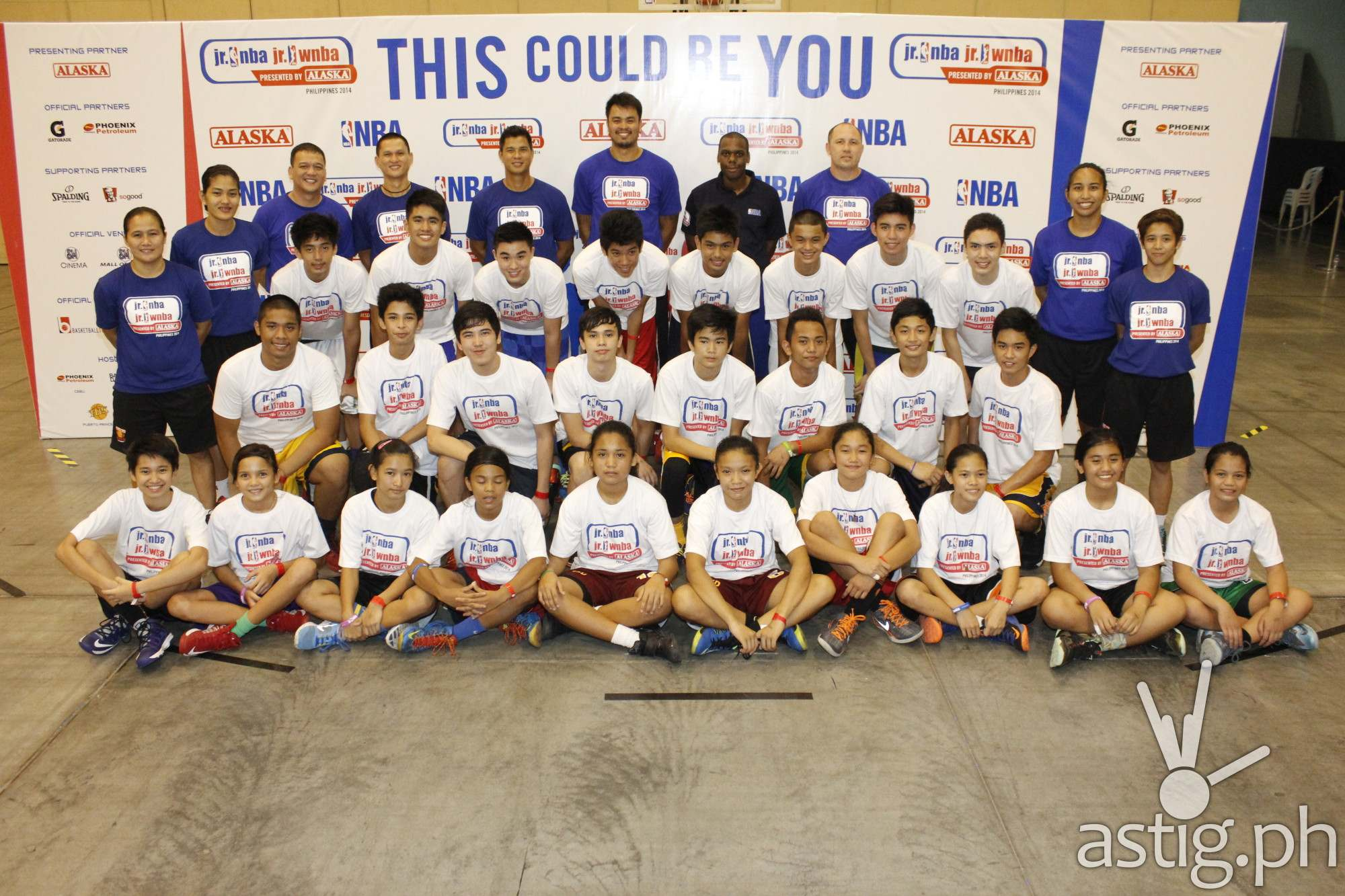 The 16 boys and 10 girls who made it to the National Training Camp of Jr. NBA/Jr. WNBA Philippines 2014 presented by Alaska with their coaches led by Jr. NBA Coach Chris Sumner (fourth from right) and Alaska coach Jojo Lastimosa (fifth from left).
