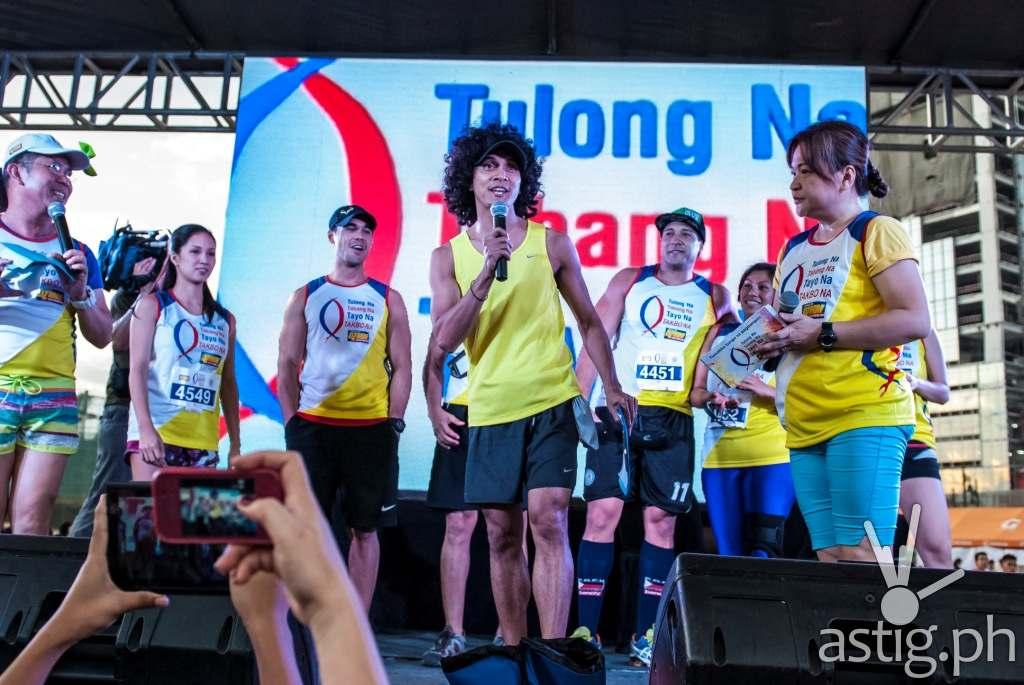 Rio dela Cruz speaks during the DZMM Takbo Na color fun run's pre-race program