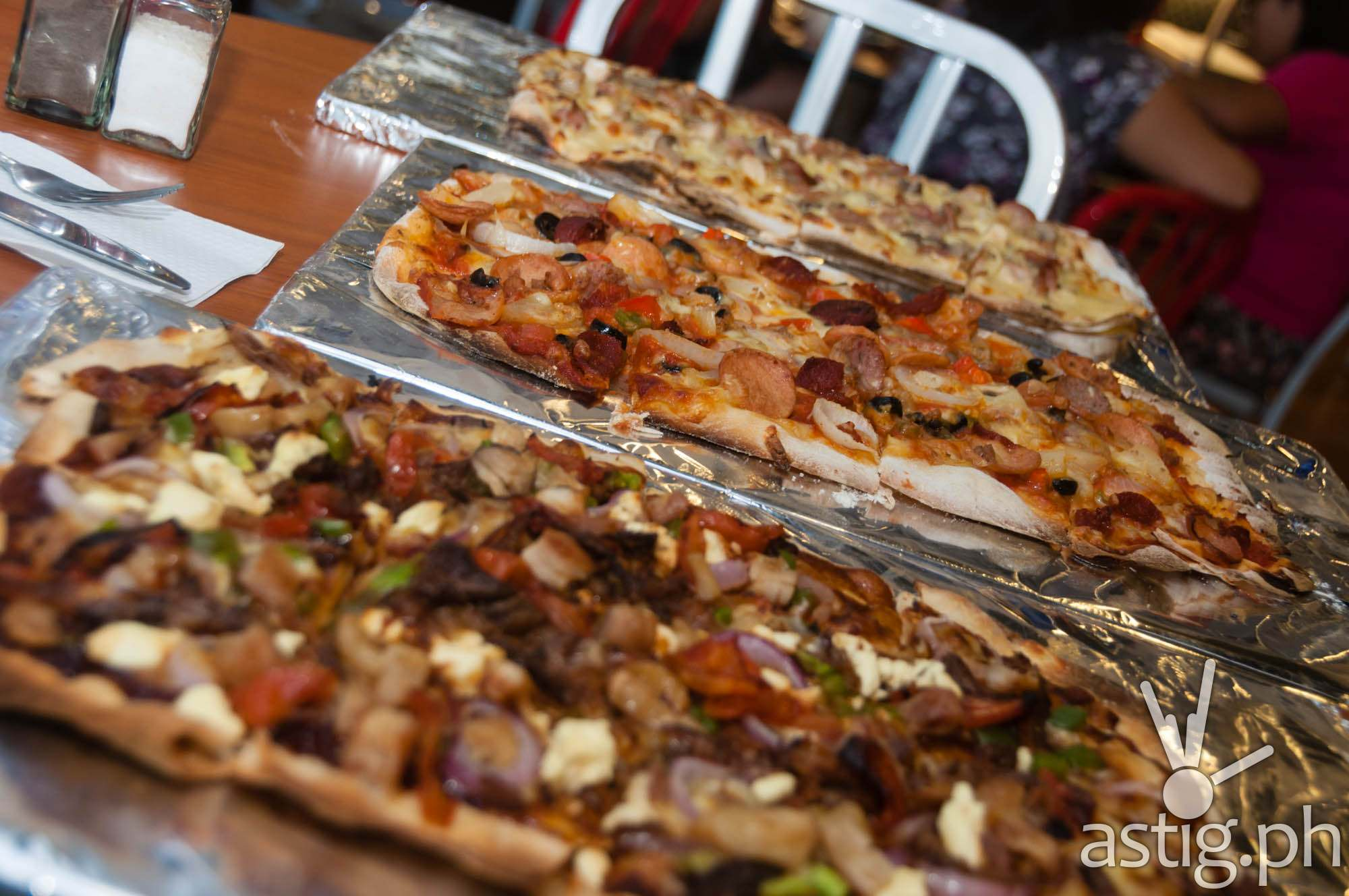 Choose between oblong, circle, and rectangle crust at Mad for Pizza