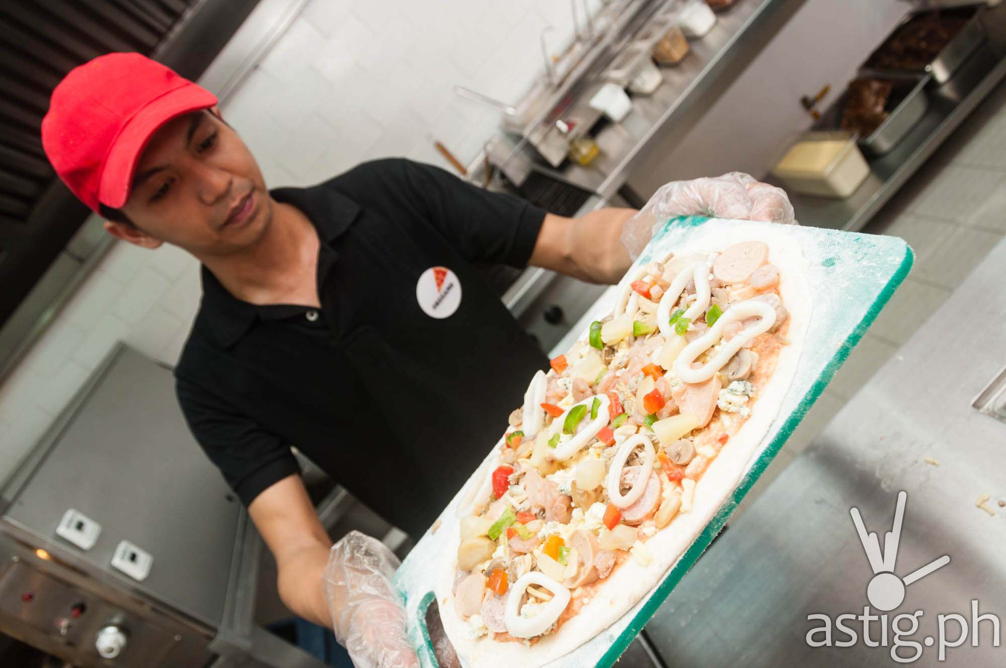 Mad for Pizza lets you create your own hand-tossed, freshly prepared pizza (280 PHP)