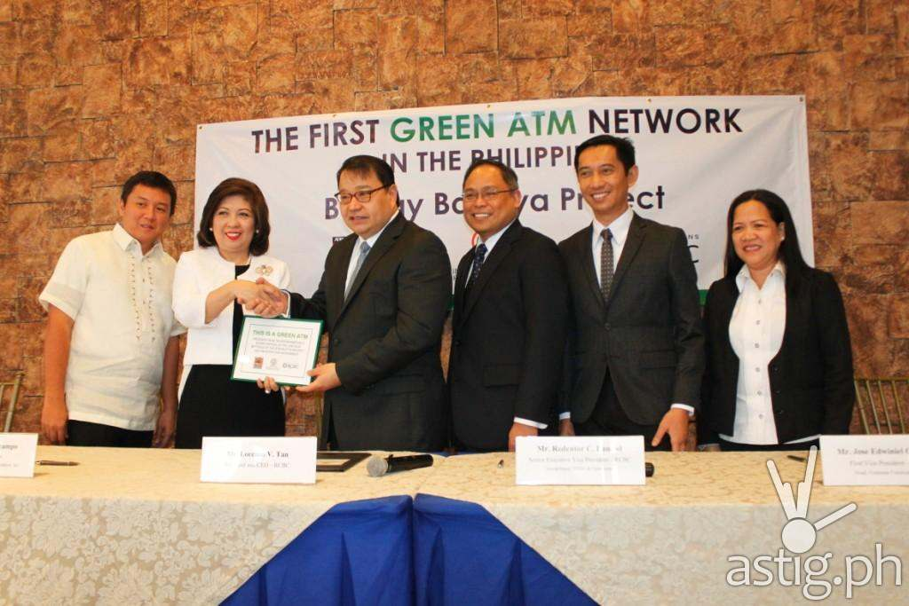 (L-R) Oriental & Motolite Marketing Corp. (OMMC) ULAB Manager Francis Isip; ALKFI Managing Director Clarissa Ocampo; RCBC President & CEO Lorenzo Tan; RCBC Senior Executive Vice-President Redentor Bancod; RCBC Vice-President for Corporate Communications Jose Edwiniel Guilas and; OMMC ULAB Supervisor Rita Regalado during the launching of First Green ATMs in the country.