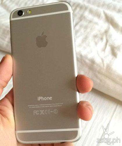 The back of a gold Apple iPhone 6