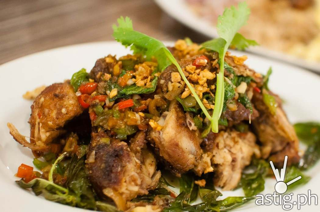 Stir fried spicy chicken in basil leaves (245 PHP) - Sweet Chili by Gerry's Grill