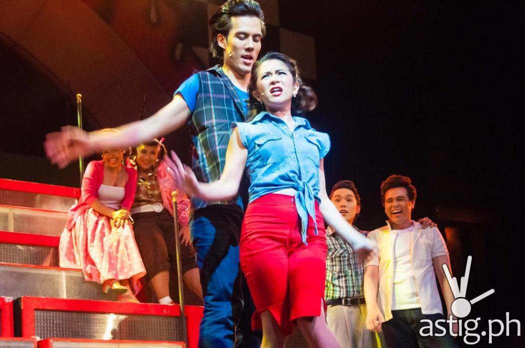 Kenickie (Rafa Siguion-Reyna) and Betty Rizzo (Antoinette Taus) - Grease by 9 Works Theatrical
