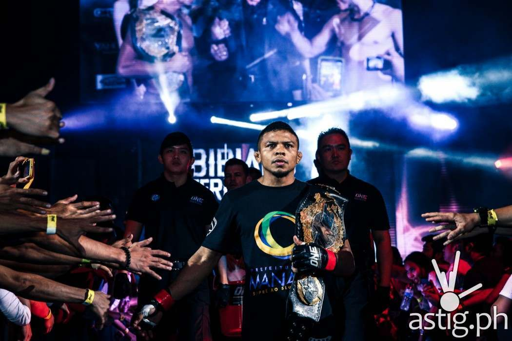 Bibiano Fernandes from Brazil enters the ring carrying the ONE FC Bantamweight World Championship belt