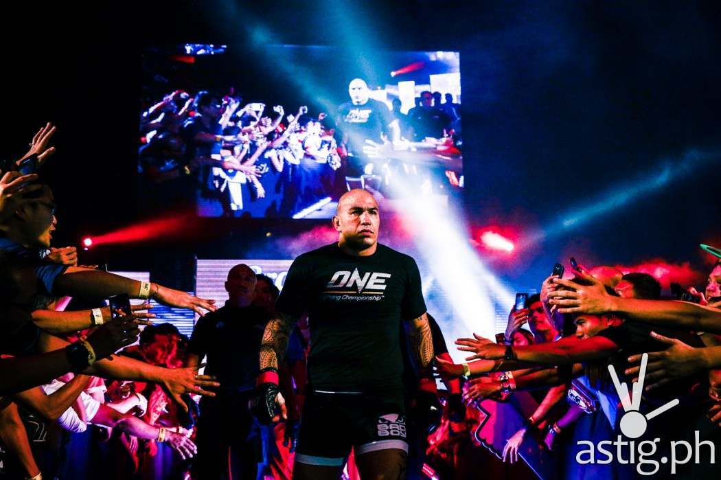 "Brandon Vera enters the ring while ""Coming Home"" by Armin Van Buuren blasts in the background"