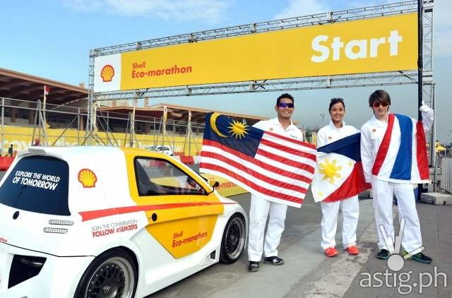 "Celebrities fly their flags at Shell FuelSave Fact or Fiction Celebrity Driving Challenge Fahrin Ahmad, Bianca Gonzlez and Pichaya ""Golf"" Nitipaisalkul fly their flags track side at Shell FuelSave Fact or Fiction Celebrity Driving Challenge Shell Eco-marathon in Manila, Philippines, Friday, Feb. 27, 2015. (Jinggo Montenejo/AP Images for Shell)"