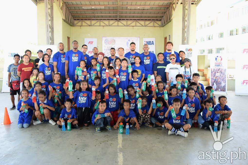 NBA player Alec Burks of the Utah Jazz together with Craig Brown, Director of NBA Basketball Operations for Southeast Asia and Carlo Singson, NBA Philippines Country Manager conducted twin NBA Cares basketball activities with Project Pearls July 30 in Bocaue Bulacan to celebrate NBA Fit Week in the Philippines