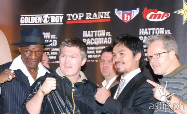 Hatton and Pacquiao with trainers by wikipedia.org