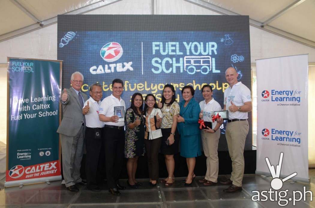 FUELLING EDUCATORS. Beneficiary teachers (4th-6th in photo) of Caloocan National Science and Technology High School now equipped with Caltex Fuel Your School STEM tools to fuel learning for their students. Joining them are (Left to right) Ebb Hinchcliffe, Executive Director of American Chamber of Commerce; Jun Salipsip, Executive Director, American Chamber Foundation Philippines Inc.; Edwin Feist, President, American Chamber Foundation Philippines Inc.; Dr. Luz Almeda, Department of Education, NCR Director; Raissa Bautista, Manager for Policy, Government, and Public Affairs Chevron Philippines Inc.; and Peter Morris, General Manager for Philippine Products, Chevron Philippines Inc.