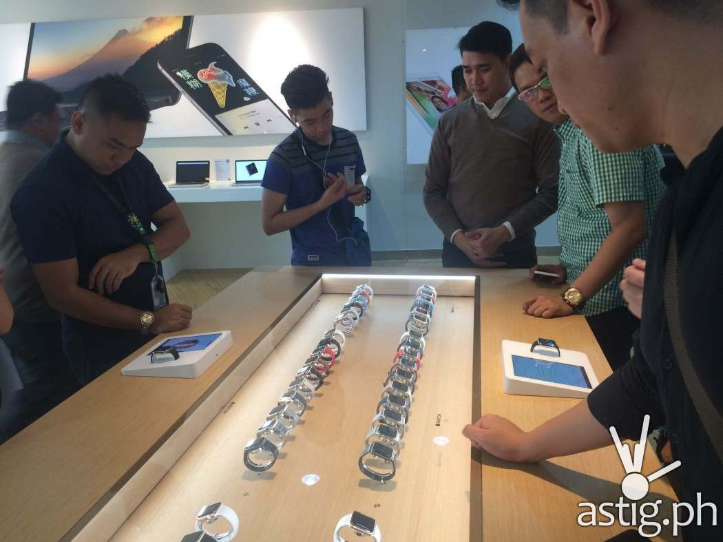 Customers check out the newly launched Apple Watch with the assistance of an Apple Watch Expert at Power Mac Center Greenbelt 3