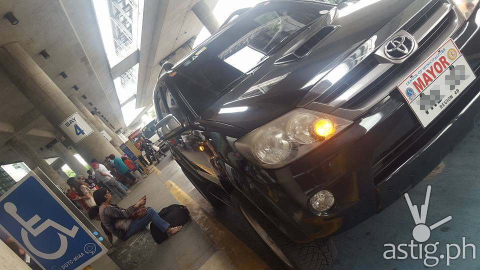 A black Toyota Fortuner with plate# VRB202 and protocol MAYOR plate attached is seen parked at the PWD area of MIAA