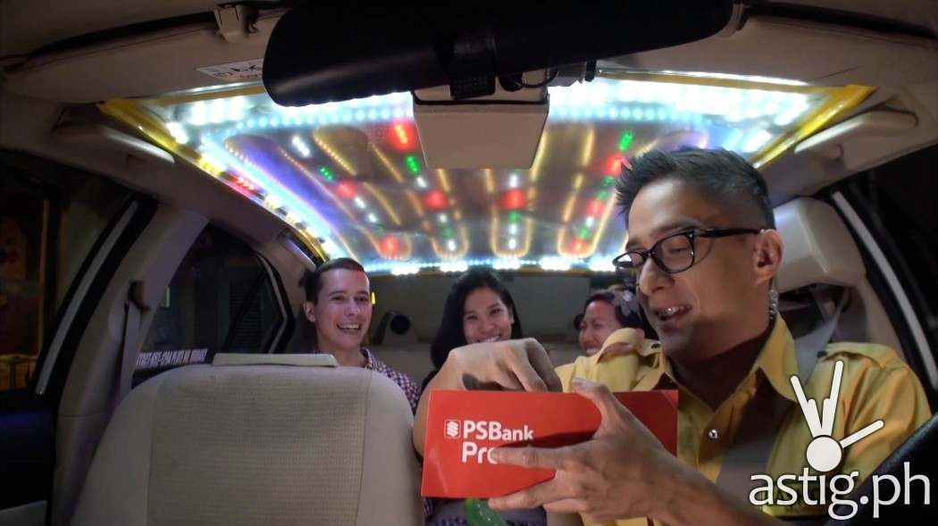 Ryan Agoncillo around in the Cash Cab - which looks like any other cab from the outside, except the driver will actually pay you!
