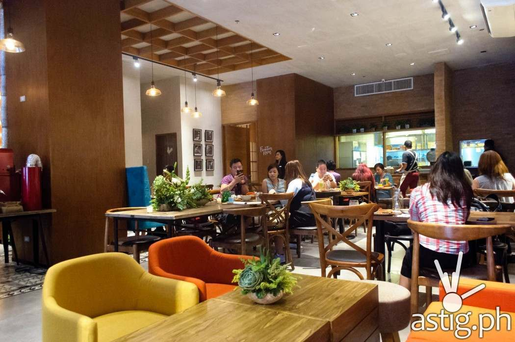 Well crafted wood furniture bring a rustic, homely feel to Café Enye