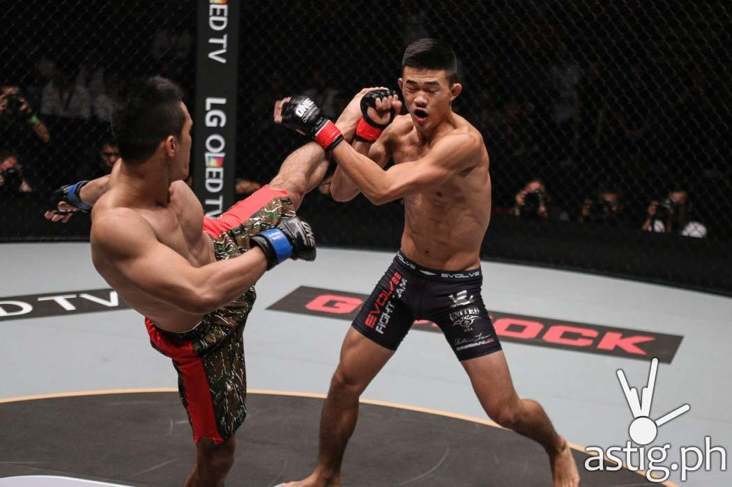"Singapore's Christian ""The Warrior"" Lee continues his meteoric rise through the ranks with his fourth straight stoppage victory, turning in a sensational performance against the Philippines' Cary ""The Prince"" Bullos to win by submission"