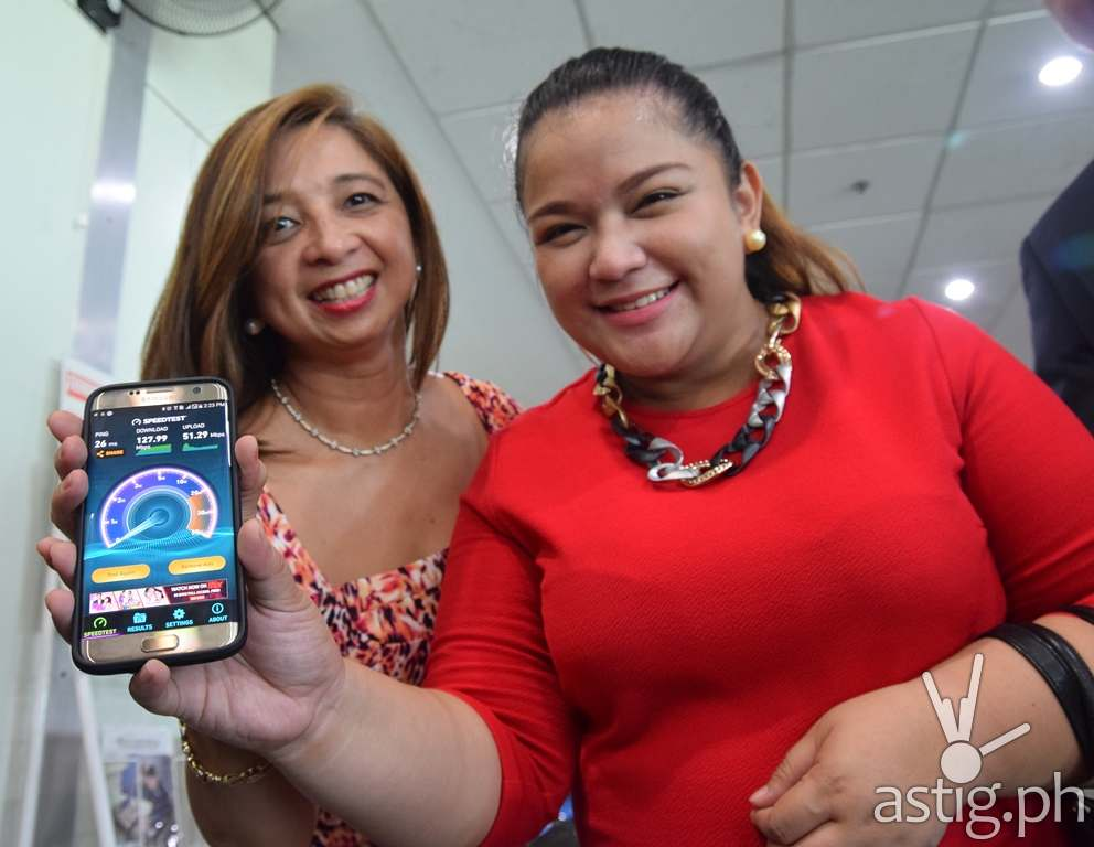 Davao City Councilor Joanne Bonguyan-Quilos (right) and Finina Tabuena-Gorres, VP for enterprise customer operations management sector at PLDT and Smart try the speed test using the Smart Wifi at the Davao City airport.