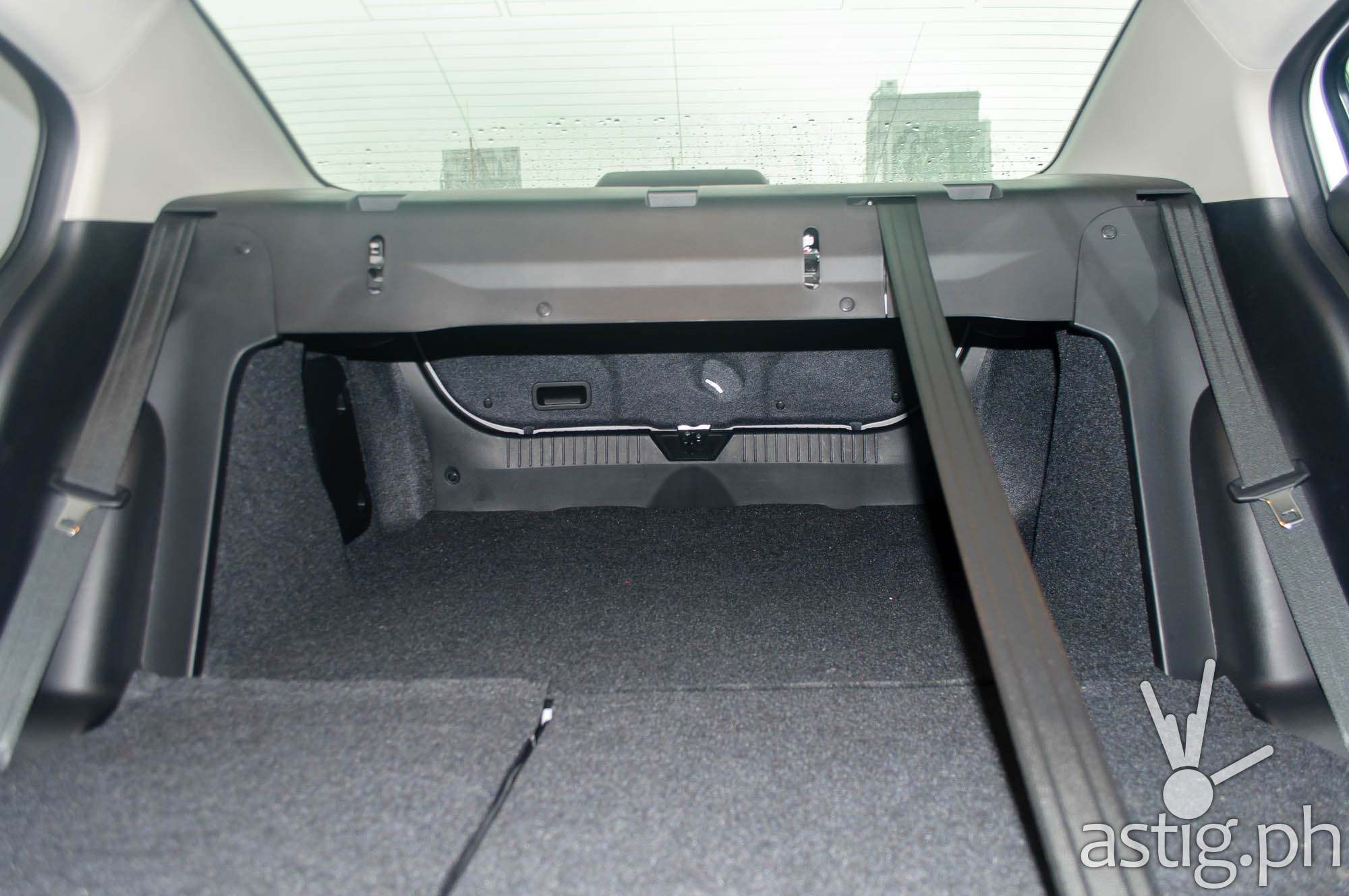 Inside shot showing the extended storage space on the Mazda3 Sedan with the rear seats folded down