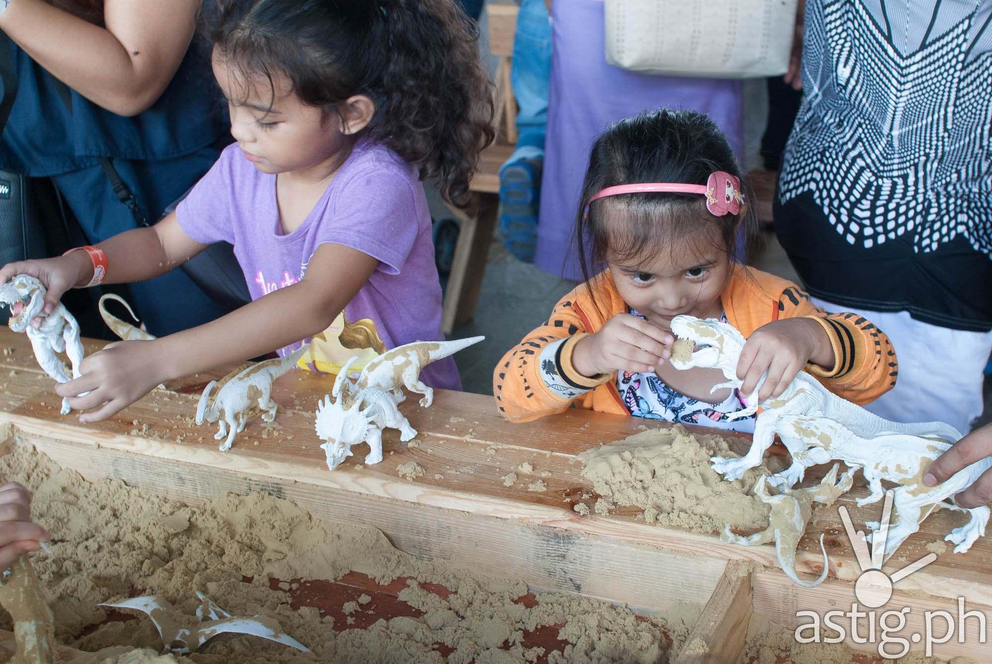 Dinosaur sandbox - Dinosaurs Around The World exhibit - Mind Museum BGC