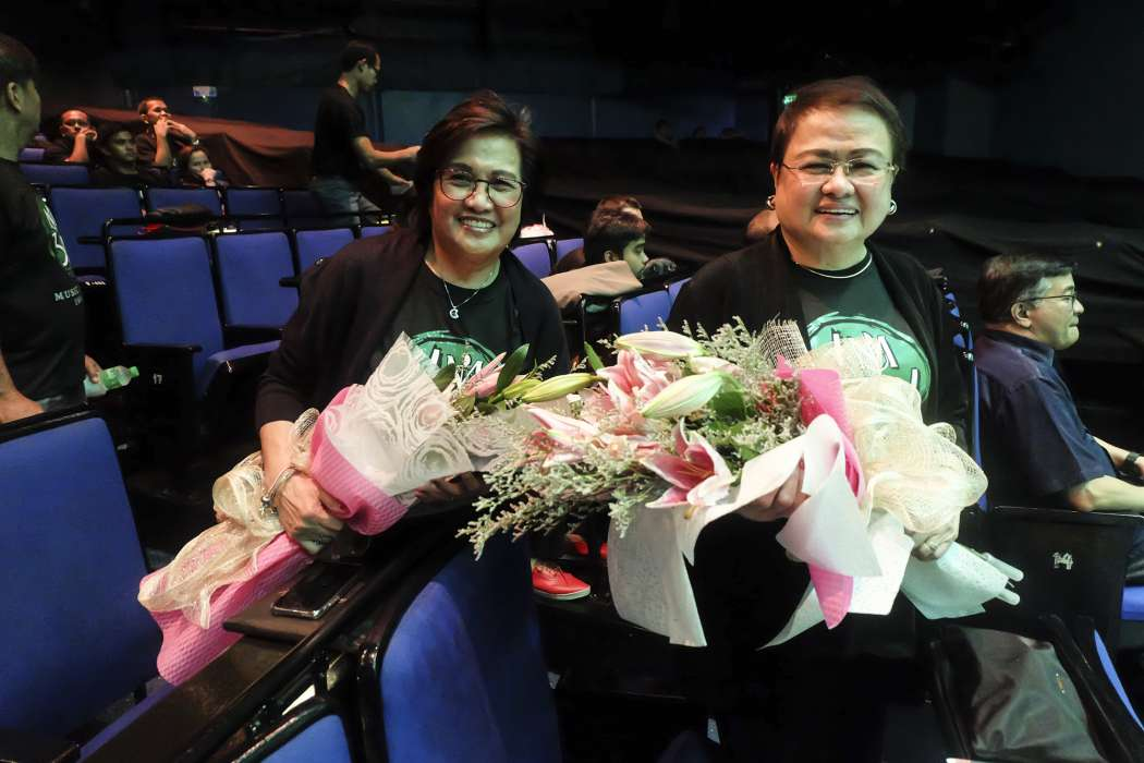 Music Museum President Precy M. Florentino and Vice President Rosie F. Mendoza receive bouquets at the intimate get together with Music Museum staff