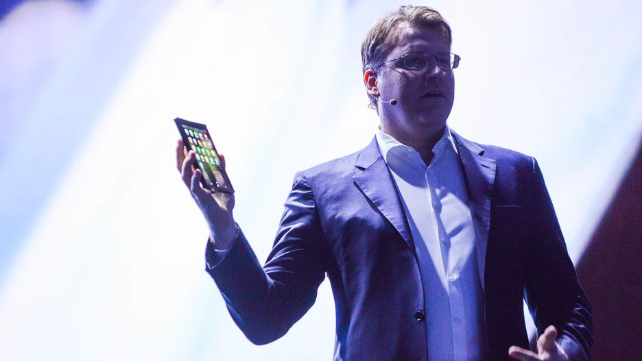 Justin Dennison, SVP for Mobile Marketing at Samsung shows the Galaxy X or Galaxy F (Photo by Angela Lang/CNET)