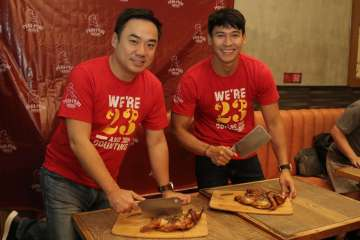 Bryan Tiu and Enchong Dee at the ceremonial chicken chopping for the grand opening of the newly-relocated Peri-Peri Charcoal Chicken and Sauce Bar at Venice Grand Canal Mall, McKinley, BGC.