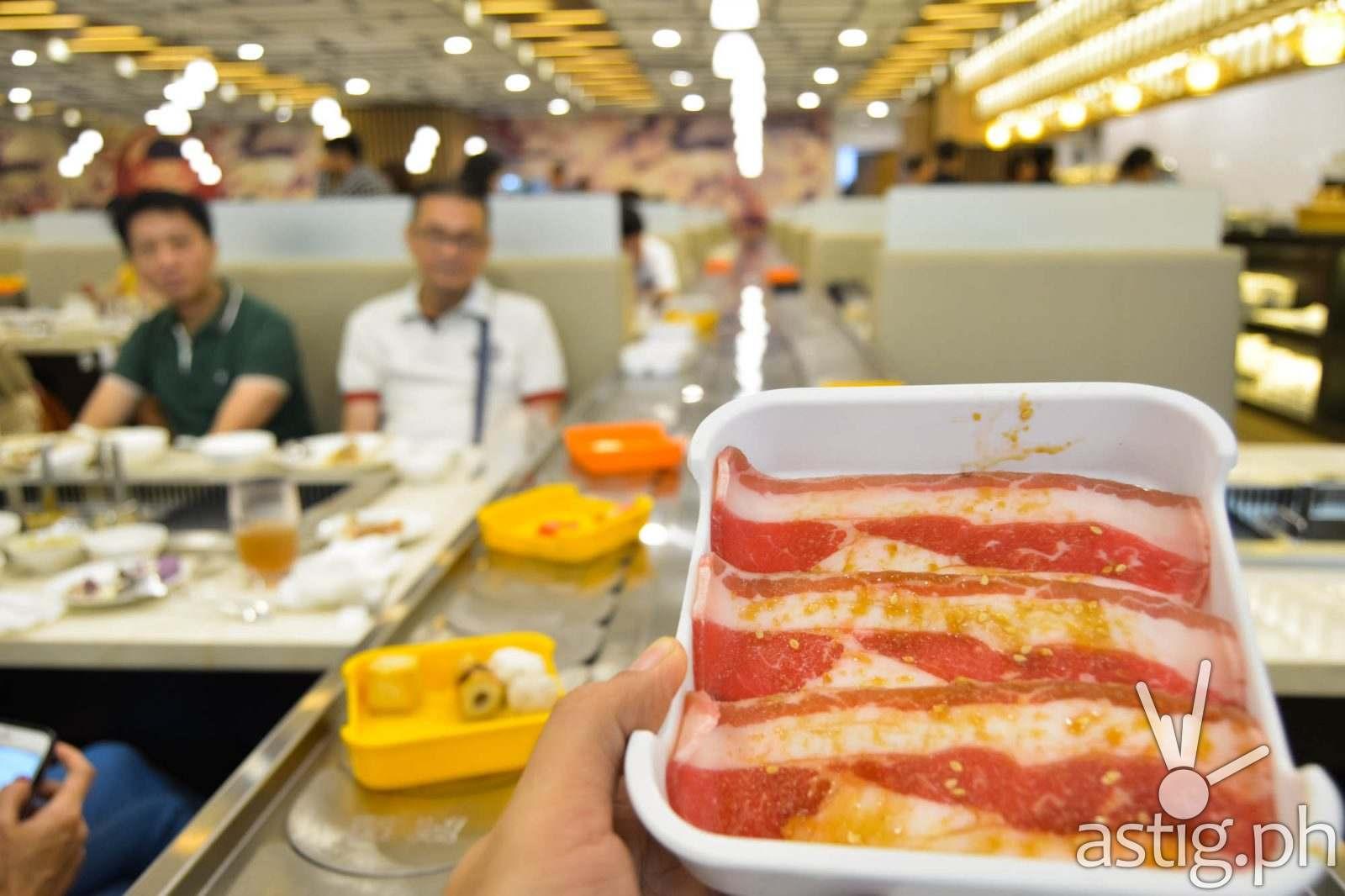 Meat conveyor belt - Hosaku International Buffet Philippines SM North Tower 2